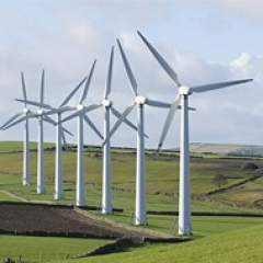 Wind turbines working to produce renewable energy