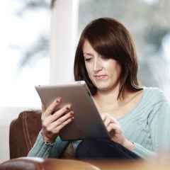A woman uses a tablet to set up a British Gas business Direct Debit