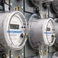 A British Gas engineer installs a new business gas smart meter