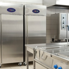 Stainless steel refrigerators in a hotel kitchen