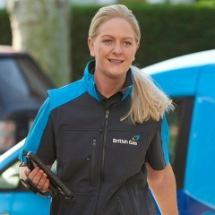 A British Gas employee walks away from her van