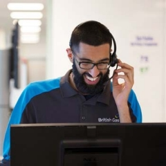 A worker answers calls wearing a headset